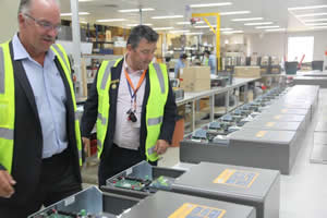 Mayor Tony Holland inspecting the production line at Selectronic Australia